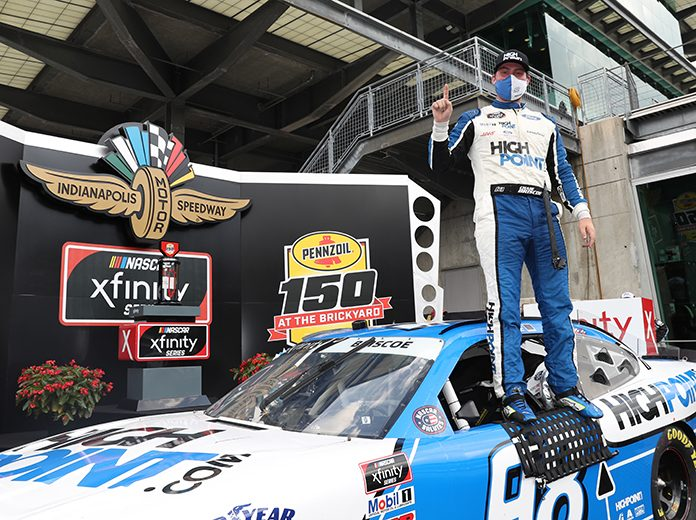 Chase Briscoe poses in victory lane after winning Saturday's Pennzoil 150 on the Indianapolis Motor Speedway road course. (IMS Photo)