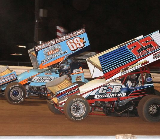 Tyler Bear (25) fends off Lance Dewease during round eight of Pennsylvania Speedweek Friday at Williams Grove Speedway. (Dan Demarco photo)