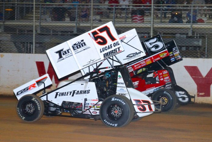 Kyle Larson (57) races under Brent Marks at Port Royal Speedway. (Dan Demarco photo)
