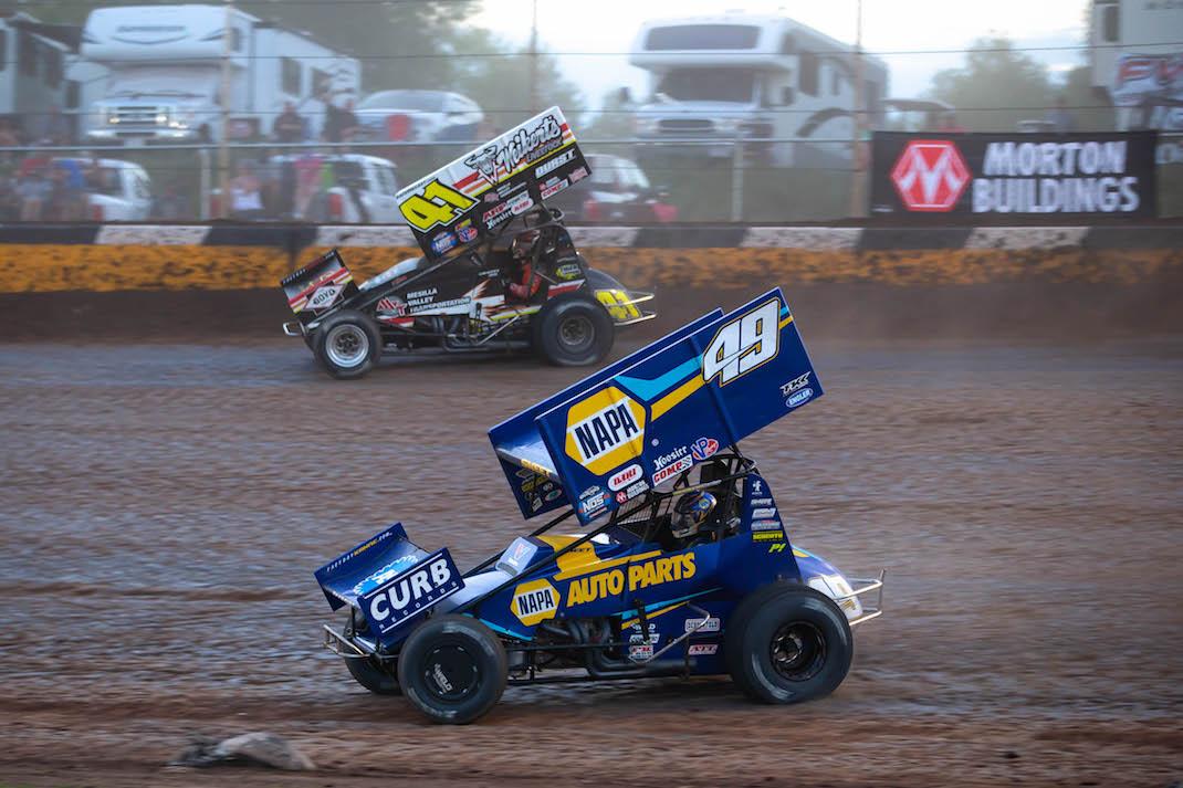 Brad Sweet (49) races under David Gravel at Cedar Lake Speedway. (Trent Gower photo)
