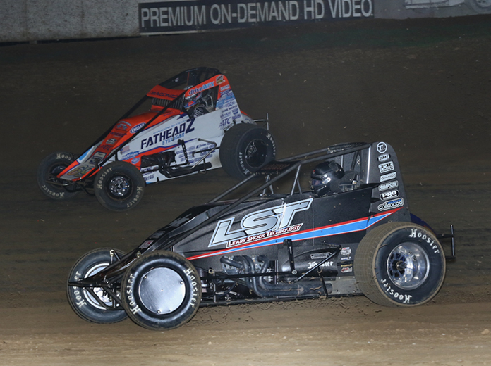 C.J. Leary (30) races under Brady Bacon during Saturday's USAC AMSOIL National Sprint Car Series feature at Lincoln Park Speedway. (Neil Cavanah Photo)
