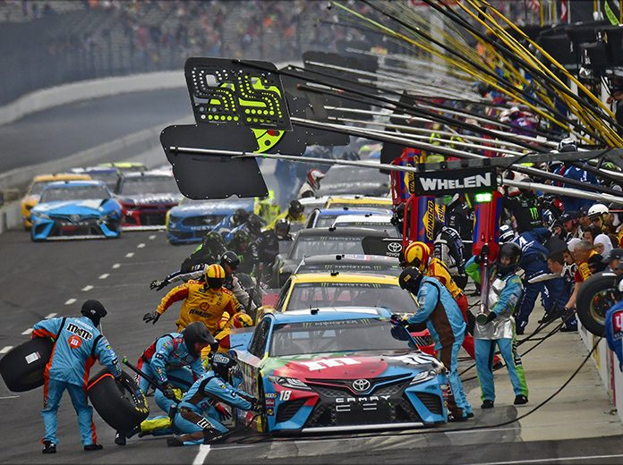 NASCAR crew member hit during chaotic pit road pileup at Indy