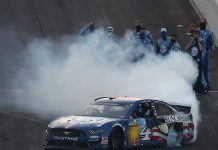 Kevin Harvick celebrates with a burnout as his crew looks on following his victory in the Big Machine Hand Sanitizer 400 Sunday at Indianapolis Motor Speedway. (Jamie Squire/Getty Images Photo)