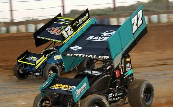 Brandon Spithaler (22) races past Darin Gallagher on Sunday evening at Tri-City Raceway Park. (Hein Brothers Photo)