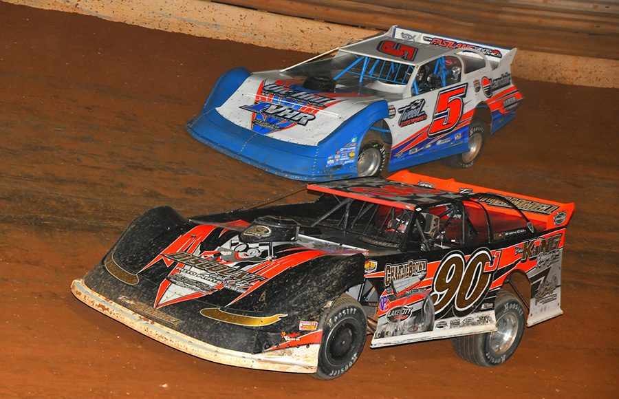 Jason Trammell (90) zips by Vic Hill for the race lead during Friday's Schaeffer's Oil Iron-Man Championship Late Model Series event at Tazewell Speedway. (Michael Moats Photo)