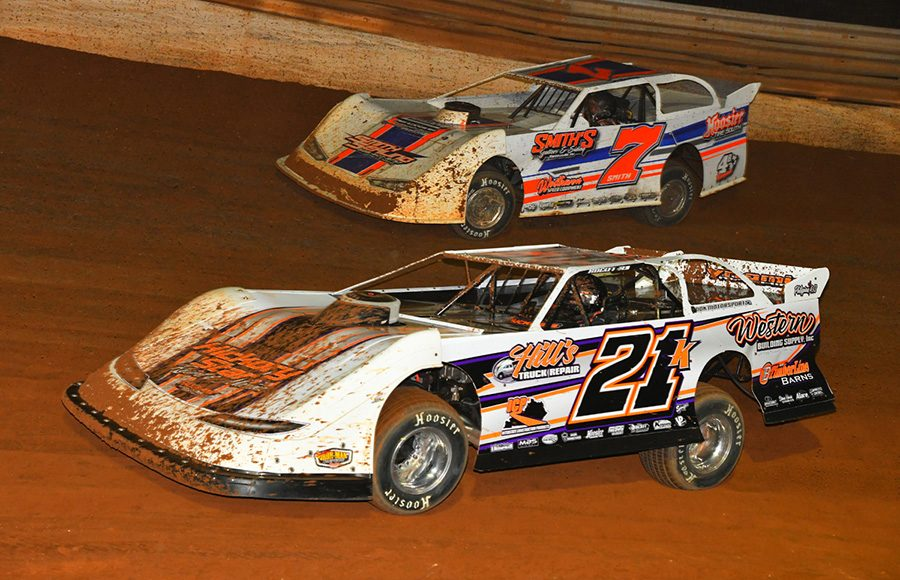Dakotah Knuckles (21) gets by Brian Smith during Friday's Schaeffer's Oil Iron-Man Championship Late Model Series event at Tazewell Speedway. (Michael Moats Photo)