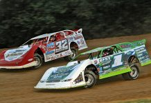 Tyler Erb (1) races under Bobby Pierce at Brownstown Speedway. (Jim DenHamer photo)