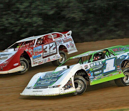 Tyler Erb (1) races under Bobby Pierce at Brownstown Speedway. (Jim DenHamer photo)