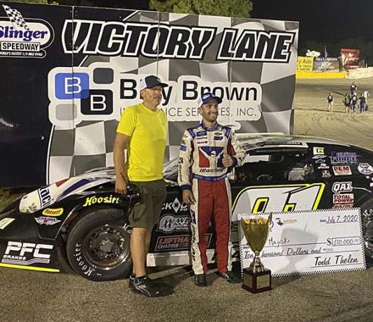 Ty Majeski (right) poses in victory lane with Slinger Super Speedway promoter Todd Thelen after winning the 41st Slinger Nationals. (Nicholas Dettmann Photo)