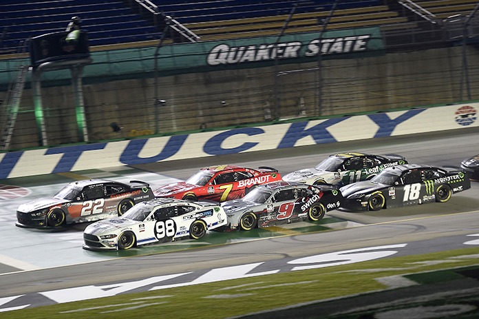 Austin Cindric (22) and Chase Briscoe (98) lead the field back to the green flag during the final restart Thursday at Kentucky Speedway. (Jared C. Tilton/Getty Images Photo)