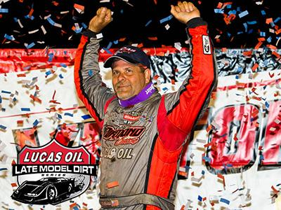Earl Pearson Jr. celebrates his victory on Friday at Florence Speedway.
