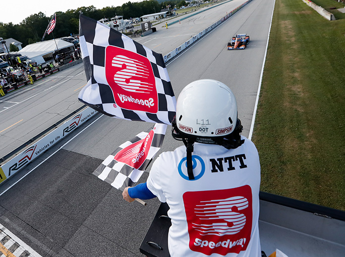 Scott Dixon takes the checkered flag to win Saturday's NTT IndyCar Series race at Road America. (IndyCar Photo)