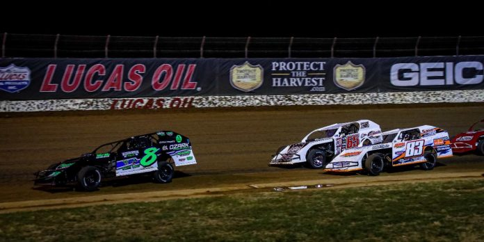Dillon McCowan (8) leads Kris Jackson (65) and JC Newell (83) on Saturday night at Lucas Oil Speedway. (GS Stanek Racing Photography)