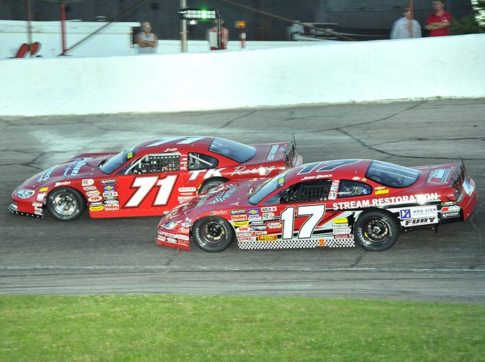 Carson Hocevar (71) leads Josh Brock during Monday's Redbud 400 at Anderson Speedway. (Randy Crist Photo)