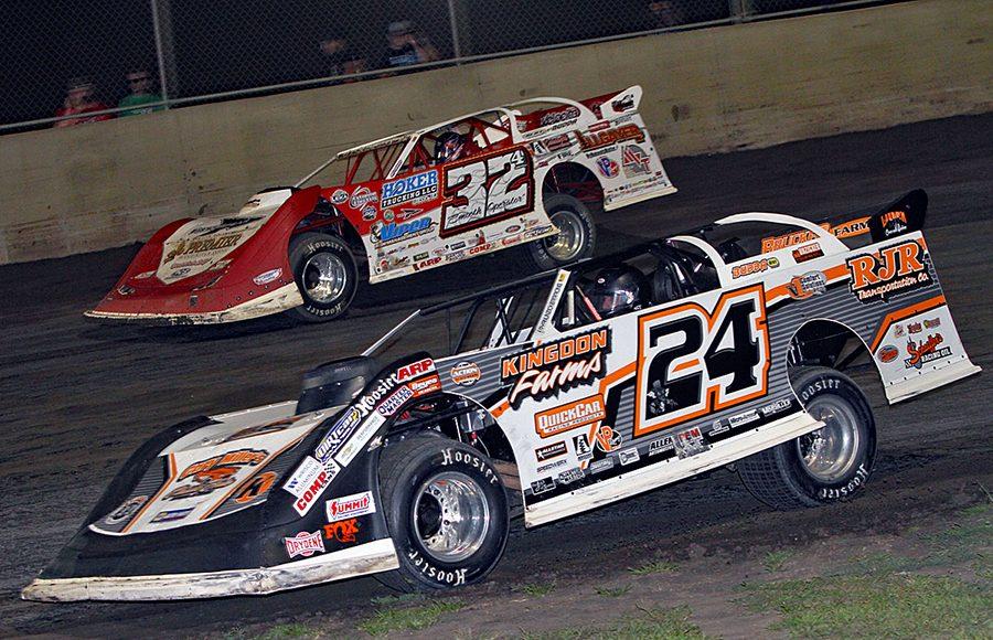 Ryan Unzicker (24) battles Bobby Pierce during Friday's DIRTcar Summer Nationals event at Tri-City Speedway. (Jim Denhamer Photo)