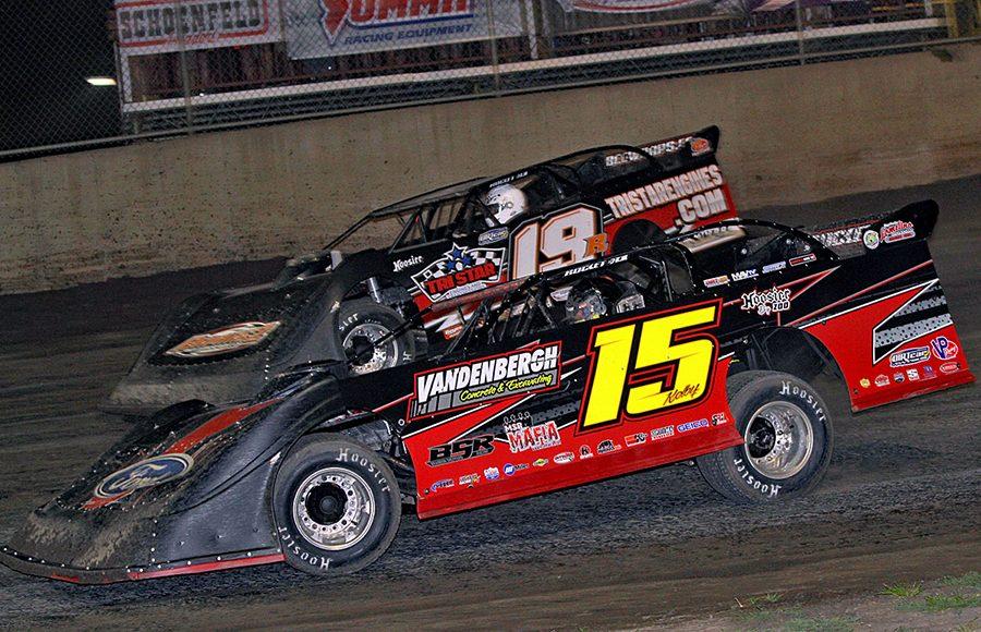 Kolby Vandenbergh (15) races alongside Ryan Gustin during Friday's DIRTcar Summer Nationals event at Tri-City Speedway. (Jim Denhamer Photo)