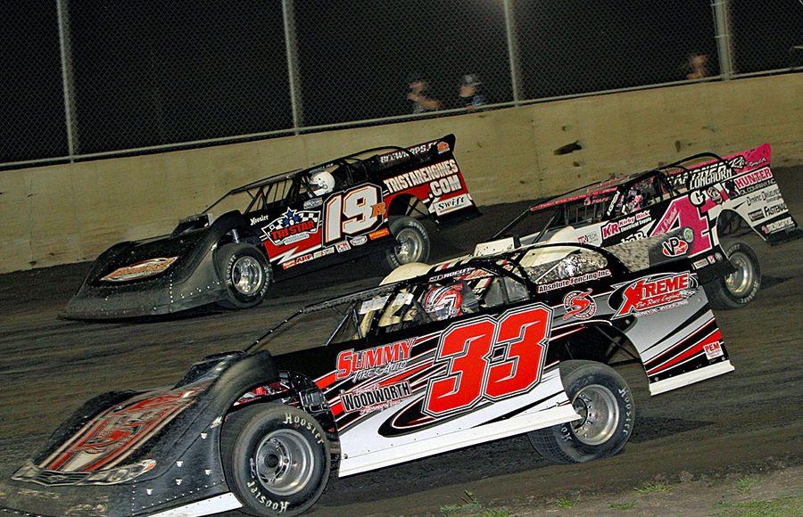 Ricky Frankel (33), Bob Gardner (4g) and Ryan Gustin race three-wide during Friday's DIRTcar Summer Nationals event at Tri-City Speedway. (Jim Denhamer Photo)