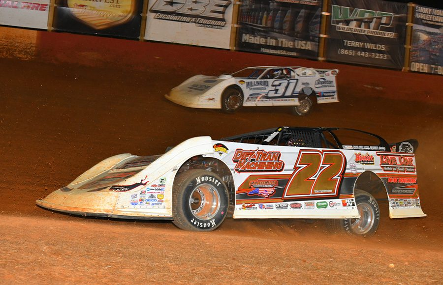 Chris Ferguson (22) races under Tyler Millwood during Friday's Schaeffer's Oil Southern Nationals Series event at Smoky Mountain Speedway. (Michael Moats Photo)