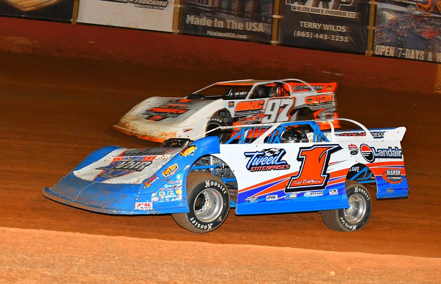 Vic Hill (1) races under Michael Chilton during Friday's Schaeffer's Oil Southern Nationals Series event at Smoky Mountain Speedway. (Michael Moats Photo)