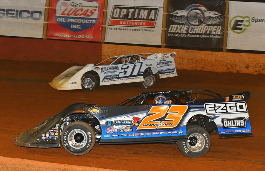 Cory Hedgecock (23) races under Tyler Millwood during Friday's Schaeffer's Oil Southern Nationals Series event at Smoky Mountain Speedway. (Michael Moats Photo)