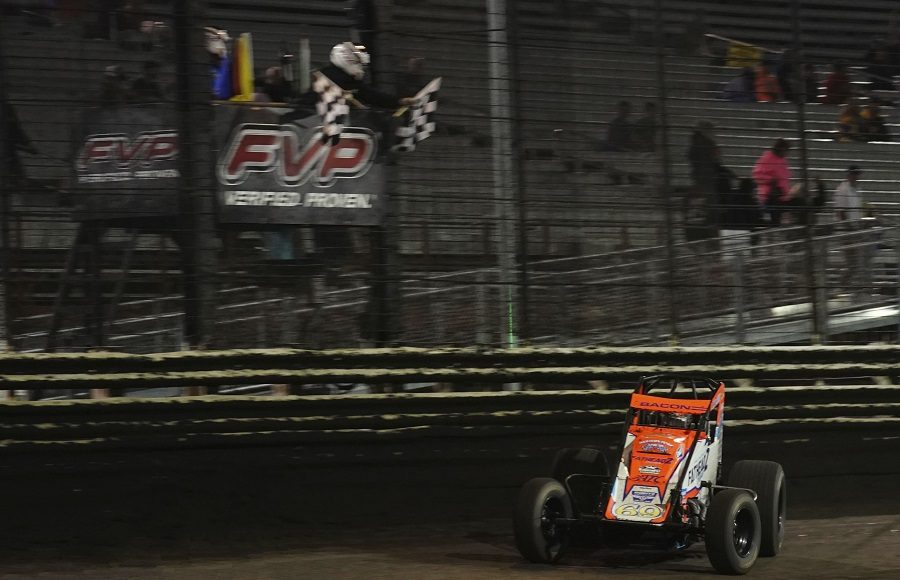 Brady Bacon takes the checkered flag to win Saturday's Brandt Corn Belt Nationals finale at Knoxville Raceway. (Ray Hague photo)