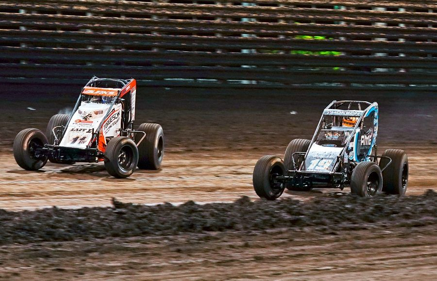 Wyatt Burks (11w) races Tanner Thorson during Saturday's Brandt Corn Belt Nationals finale at Knoxville Raceway. (Ray Hague photo)