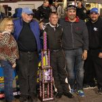 (From left) Sandy Hamke, Robert Hamke, Preston Peltier, Robby Hamke and an unidentified fifth person share victory lane after Peltier won the 2016 Easter Bunny 150 at Hickory Motor Speedway driving Robert Hamke's house car. (Adam Fenwick Photo)