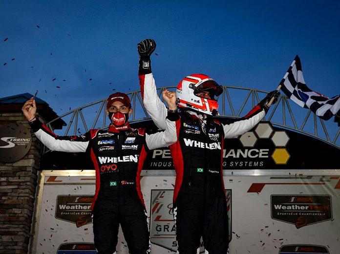 Pipo Derani and Felipe Nasr celebrate after winning Saturday's Cadillac Grand Prix at Sebring Int'l Raceway. (IMSA Photo)