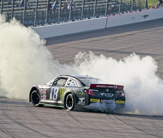 Ty Gibbs celebrates with a burnout after his victory Saturday at Iowa Speedway. (Ray Hague Photo)
