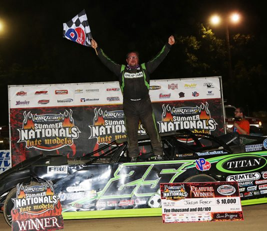 Jason Feger in victory lane Saturday at Highland Speedway. (Terry Page Photo)