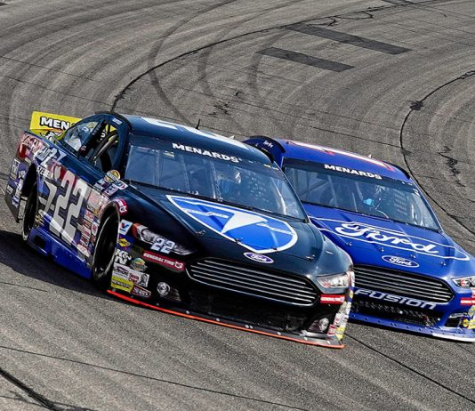 Kody Swanson (22) battles Taylor Gray during Saturday's ARCA Menards Series event at Iowa Speedway. (Ray Hague Photo)