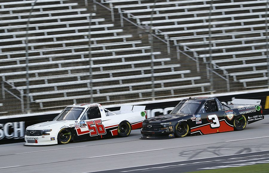 Timmy Hill (56) battles Jordan Anderson during Saturday's NASCAR Gander RV & Outdoors Truck Series event at Texas Motor Speedway. (HHP/Harold Hinson Photo)