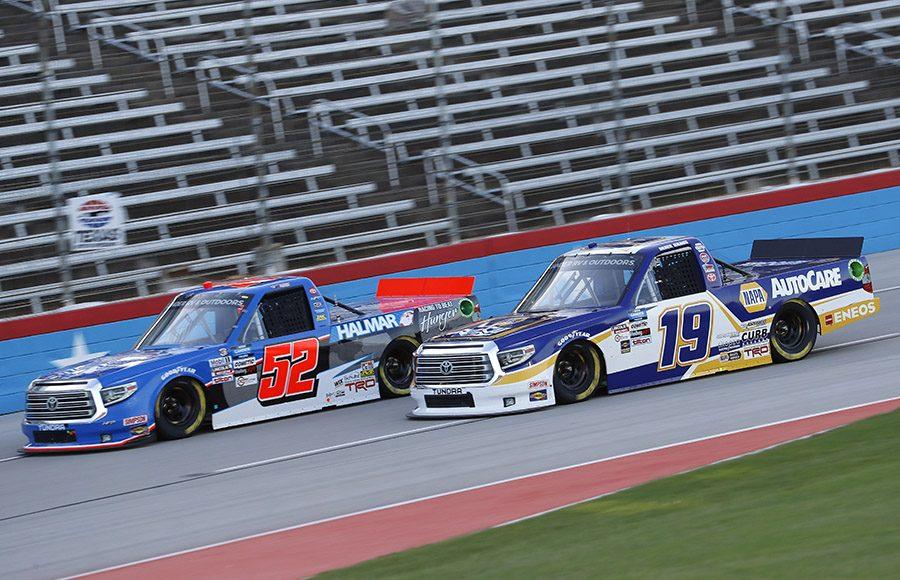 Derek Kraus (19) battles Stewart Friesen during Saturday's NASCAR Gander RV & Outdoors Truck Series event at Texas Motor Speedway. (HHP/Harold Hinson Photo)