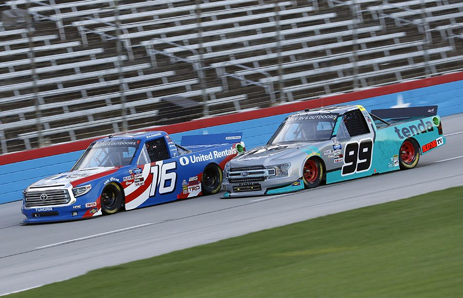 Austin Hill (16) races to the outside of Ben Rhodes during Saturday's NASCAR Gander RV & Outdoors Truck Series event at Texas Motor Speedway. (HHP/Harold Hinson Photo)