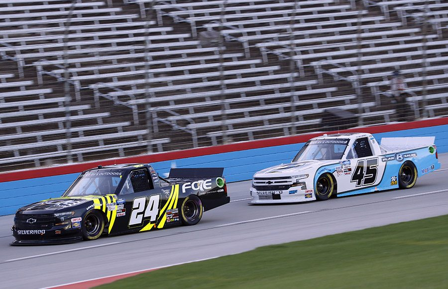 Justin Haley (24) leads Ty Majeski during Saturday's NASCAR Gander RV & Outdoors Truck Series event at Texas Motor Speedway. (HHP/Harold Hinson Photo)
