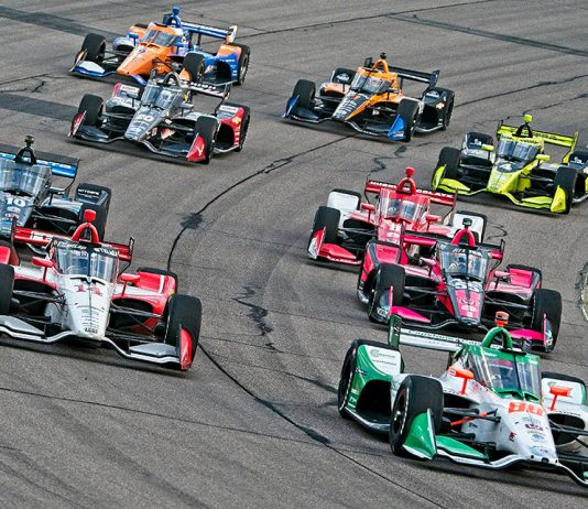 Drivers battle for position during Saturday's NTT IndyCar Series race at Iowa Speedway. (Ray Hague Photo)