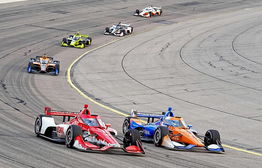 Scott Dixon (10) and Marcus Ericsson battle for position during Saturday's NTT IndyCar Series race at Iowa Speedway. (Ray Hague Photo)