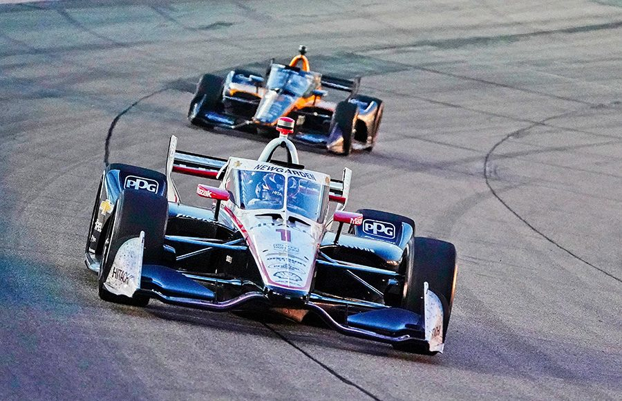 Josef Newgarden (1) leads a pack of cars during Saturday's NTT IndyCar Series race at Iowa Speedway. (Ray Hague Photo)