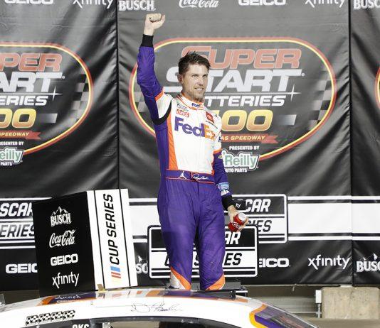 Denny Hamlin celebrates after earning his fifth NASCAR Cup Series victory of the season Thursday at Kansas Speedway. (HHP/Harold Hinson Photo)