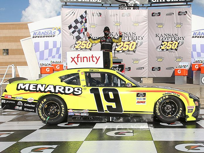 Brandon Jones in victory lane Saturday at Kansas Speedway. (Jamie Squire/Getty Images Photo)