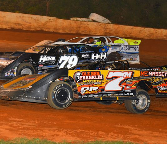 Donald McIntosh (7m) and Kyle Hardy (79) bypass a slower car during Friday's Schaeffer's Oil Southern Nationals Series feature at 411 Motor Speedway. (Michael Moats Photo)
