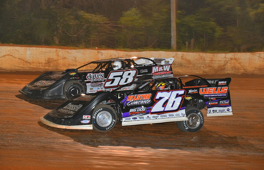 Brandon Overton (76) races alongside Ross Bailes during Friday's Schaeffer's Oil Southern Nationals Series feature at 411 Motor Speedway. (Michael Moats Photo)