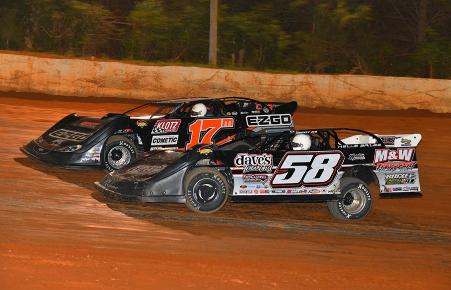 Ross Bailes (58) battles Dale McDowell during Friday's Schaeffer's Oil Southern Nationals Series feature at 411 Motor Speedway. (Michael Moats Photo)
