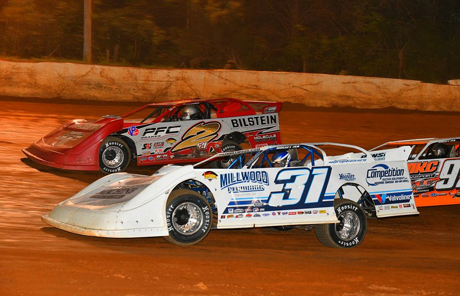 Tyler Millwood (31) races under Pearson Lee Williams during Friday's Schaeffer's Oil Southern Nationals Series feature at 411 Motor Speedway. (Michael Moats Photo)
