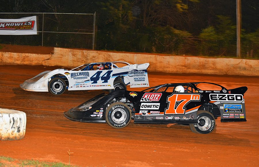 Dale McDowell (17m) races alongside Chris Madden during Friday's Schaeffer's Oil Southern Nationals Series feature at 411 Motor Speedway. (Michael Moats Photo)