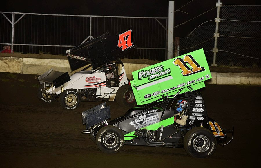 Colton Fisher (11) battles Terry Babb during Friday's Morrow Brothers Ford MOWA Sprint Car Series event at Jacksonville Speedway. (Mark Funderburk Photo)