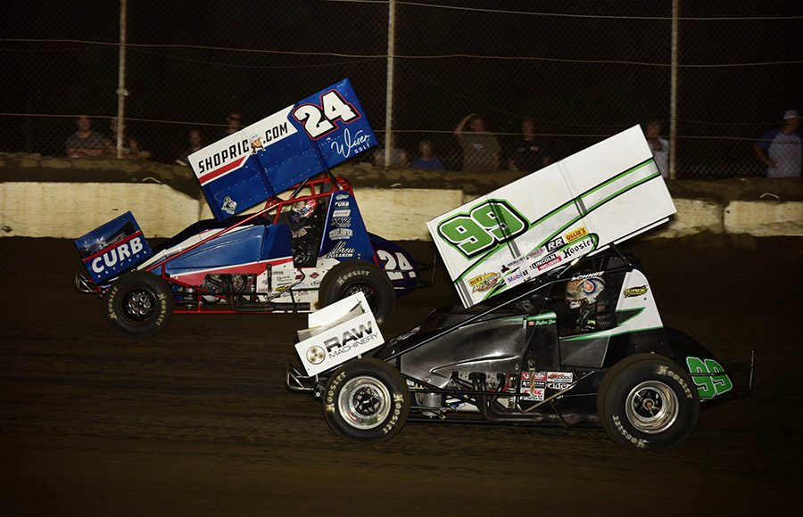 Skylar Gee (99) races eventual winner Rico Abreu during Friday's Morrow Brothers Ford MOWA Sprint Car Series event at Jacksonville Speedway. (Mark Funderburk Photo)