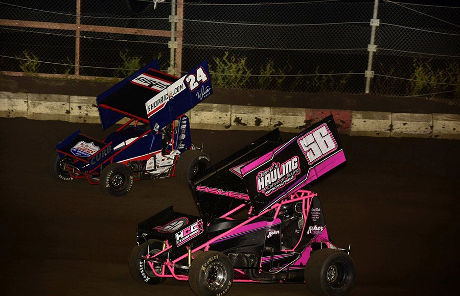 Jeff Asher (56) battles Rico Abreu during Friday's Morrow Brothers Ford MOWA Sprint Car Series event at Jacksonville Speedway. (Mark Funderburk Photo)