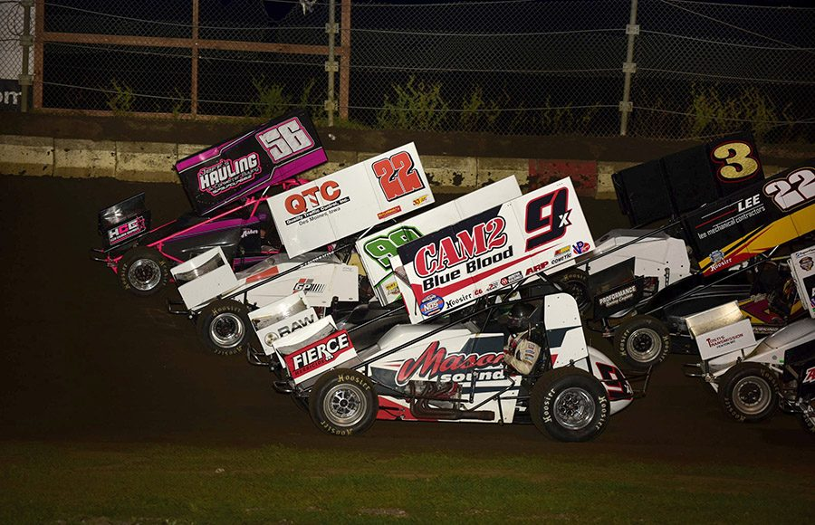 The field for Friday's Morrow Brothers Ford MOWA Sprint Car Series event at Jacksonville Speedway prepares to go racing. (Mark Funderburk Photo)