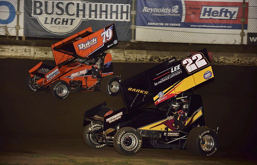 Jacob Patton (79) battles Dustin Barks during Friday's Morrow Brothers Ford MOWA Sprint Car Series event at Jacksonville Speedway. (Mark Funderburk Photo)